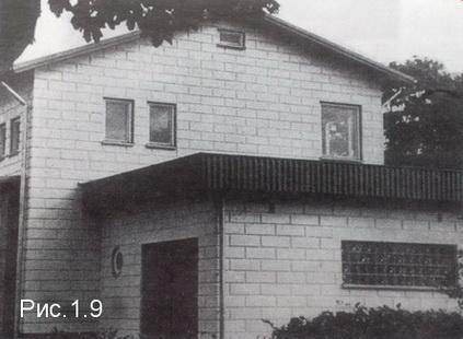 мелкоблочный дом с гаражок из блоков под расшивку